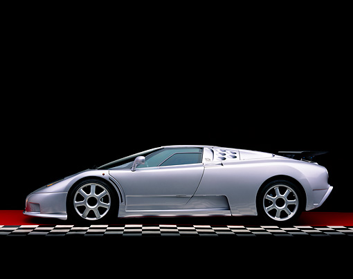 AUT 02 RK0065 05 © Kimball Stock 1994 Bugatti EB110 SS Silver Profile On Checkered Line Red Floor Studio
