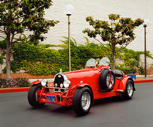 AUT 02 RK0075 01 © Kimball Stock 1929 Bugatti T45 Convertible Red 3/4 Front View On Pavement