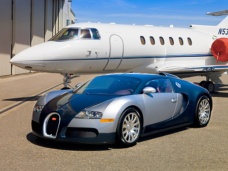 AUT 02 RK0086 02 © Kimball Stock 2007 Bugatti Veyron Silver And Blue 3/4 Front By Airplane