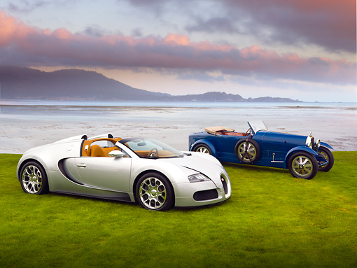 AUT 02 RK0112 01 © Kimball Stock 2008 Bugatti Veyron 16.4 Grand Sport Roadster Silver And 1929 Bugatti Type 43 Grand Sport Blue 3/4 Front View On Grass By Ocean