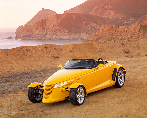 AUT 03 RK0019 04 © Kimball Stock 1999 Plymouth Prowler Roadster Yellow 3/4 Front View On Beach