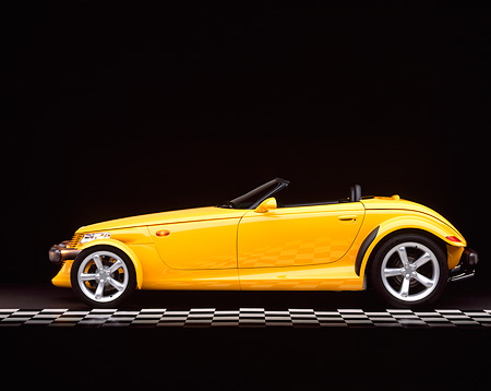 AUT 03 RK0001 02 © Kimball Stock 1999 Plymouth Prowler Roadster Yellow Profile On Checkered Line Studio