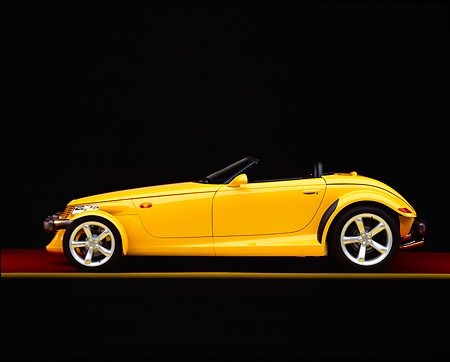 AUT 03 RK0002 06 © Kimball Stock 1999 Plymouth Prowler Roadster Yellow Profile On Red Floor Yellow Line Studio