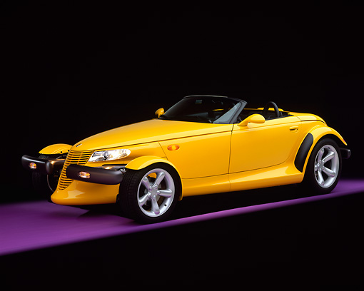 AUT 03 RK0006 01 © Kimball Stock 1999 Plymouth Prowler Roadster Yellow Side 3/4 View On Purple Floor Studio
