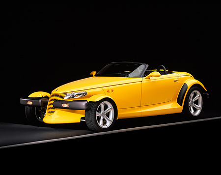 AUT 03 RK0007 07 © Kimball Stock 1999 Plymouth Prowler Roadster Yellow 3/4 Side View On Gray Line Studio