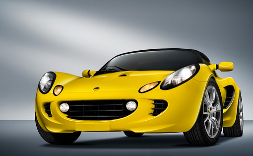 AUT 04 IZ0009 01 © Kimball Stock 2009 Lotus Elise Yellow 3/4 Front View Studio