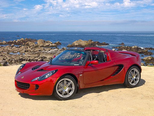 AUT 04 RK0166 01 © Kimball Stock 2009 Lotus Elise SC Red 3/4 Front View By Ocean
