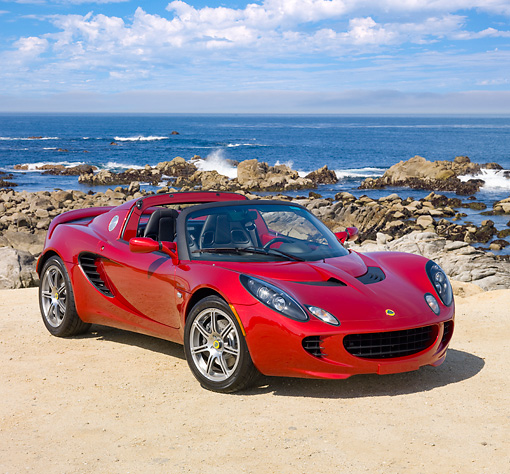 AUT 04 RK0167 01 © Kimball Stock 2009 Lotus Elise SC Red 3/4 Front View By Ocean