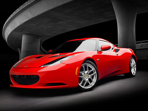AUT 04 RK0176 01 © Kimball Stock 2013 Lotus Evora Red 3/4 Front View Under Overpass