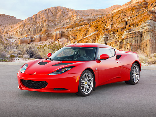 AUT 04 RK0188 01 © Kimball Stock 2013 Lotus Evora Red 3/4 Front View On Pavement By Cliffs
