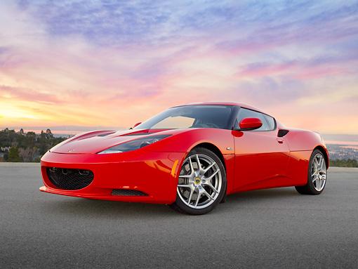 AUT 04 RK0189 01 © Kimball Stock 2013 Lotus Evora Red 3/4 Front View On Pavement At Sunset