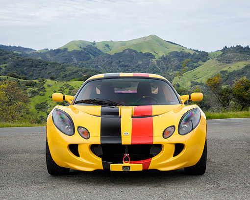 AUT 04 RK0199 01 © Kimball Stock 2010 Lotus Elise Yellow Front View By Mountains And Trees