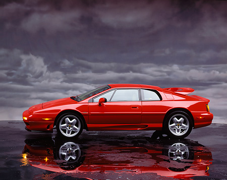 AUT 04 RK0026 05 © Kimball Stock 1994 Lotus Esprit S4 Turbo Red Profile View Gray Clouds Studio