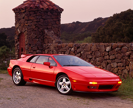 AUT 04 RK0029 20 © Kimball Stock 1994 Lotus Esprit S-4 Turbo Red 3/4 Front View By Stone Wall