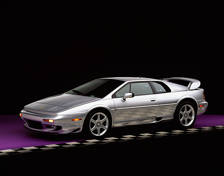 AUT 04 RK0040 01 © Kimball Stock 1999 Lotus Esprit V8 Silver Side 3/4 View On Purple Floor Checkered Line Studio