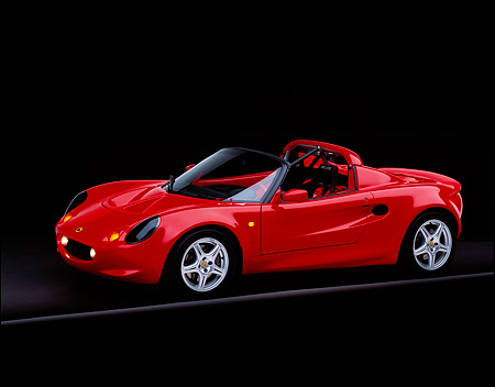 AUT 04 RK0051 08 © Kimball Stock 1999 Lotus Elise Sport 190 Red 3/4 Side View On Gray Line Studio