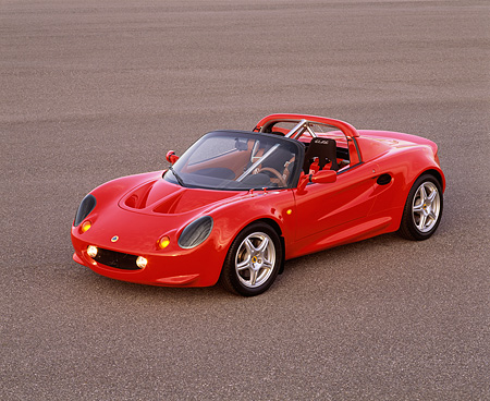 AUT 04 RK0059 09 © Kimball Stock 1999 Lotus Elise Sport 190 Red 3/4 Front View On Pavement