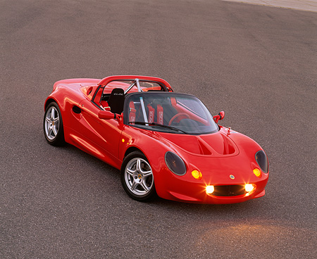 AUT 04 RK0060 04 © Kimball Stock 1999 Lotus Elise Sport 190 Red Overhead 3/4 Front View On Pavement