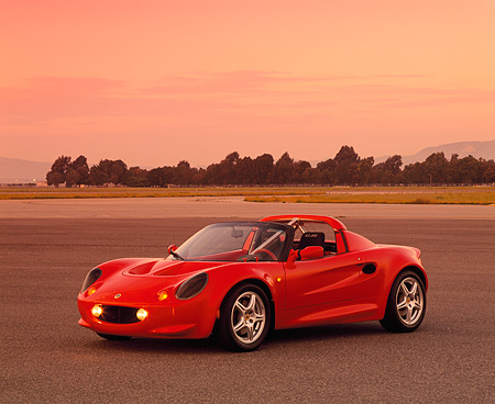 AUT 04 RK0062 01 © Kimball Stock 1999 Lotus Elise Sport 190 Red 3/4 Side View On Pavement Filtered