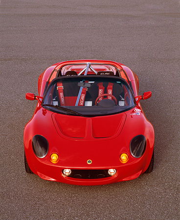 AUT 04 RK0063 04 © Kimball Stock 1999 Lotus Elise Sport 190 Overhead Front View On Pavement