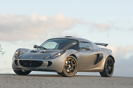 AUT 04 RK0129 01 © Kimball Stock 2006 Lotus Exige Silver 3/4 Front View On Pavement Blue Sky