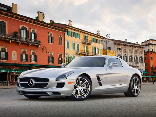 AUT 05 BK0004 01 © Kimball Stock 2011 Mercedes-Benz SLS AMG Silver 3/4 Front View On Pavement By Buildings