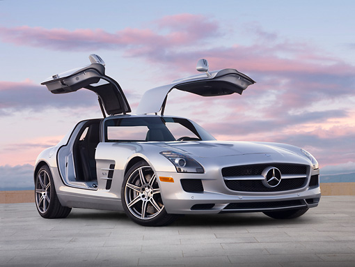 AUT 05 BK0007 01 © Kimball Stock 2011 Mercedes-Benz SLS AMG Silver Profile View On Concrete Steps At Dusk