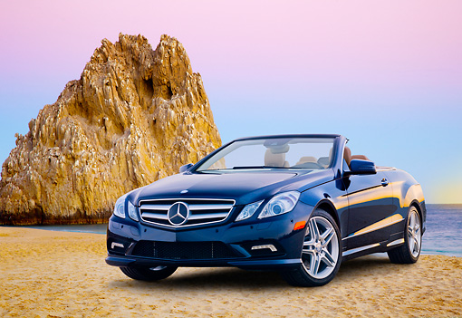 AUT 05 BK0008 01 © Kimball Stock 2011 Mercedes-Benz E550 Cabriolet Blue 3/4 Front View On Beach