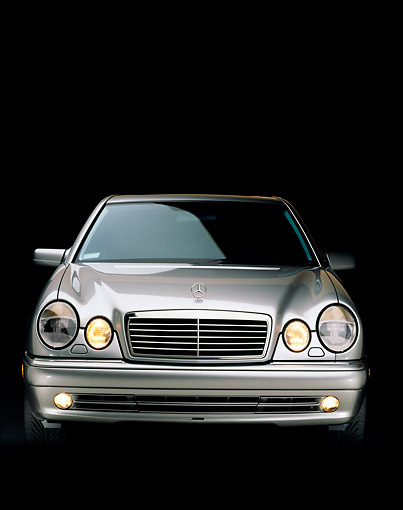 AUT 05 RK0116 02 © Kimball Stock 1999 Mercedes-Benz E55 AMG Silver Head On Studo
