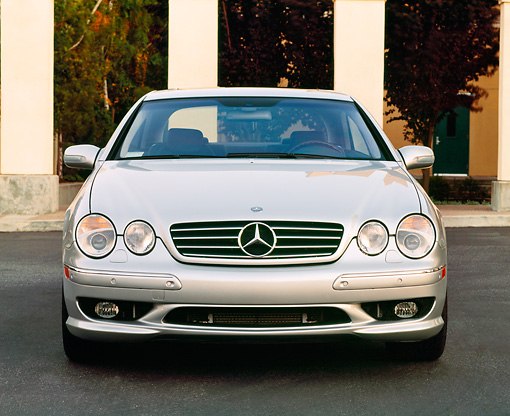 AUT 05 RK0185 01 © Kimball Stock 2001 Mercedes-Benz CL600 Silver Head On Shot By Pillars On Pavement