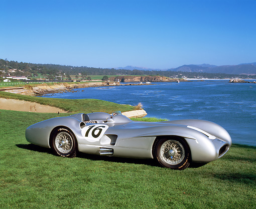 AUT 05 RK0212 02 © Kimball Stock 1954 Mercedes W196 Race Car Silver 3/4 Side View On Grass By Water