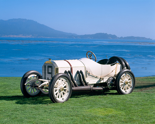 AUT 05 RK0215 02 © Kimball Stock 1908 Mercedes Grand Prix White 3/4 Side View On Grass By Water