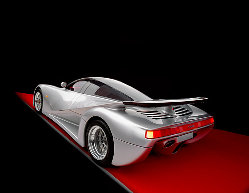 AUT 05 RK0335 09 © Kimball Stock 1991 Mercedes Lotec C1000 Silver Slanted 3/4 Rear View On Red Floor Studio