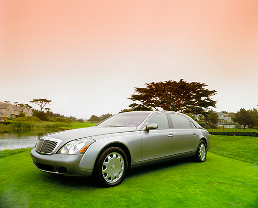 AUT 05 RK0359 02 © Kimball Stock 2004 Maybach 62 Sedan Two-Tone Silver 3/4 Front View On Grass Filtered
