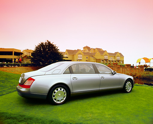 AUT 05 RK0360 02 © Kimball Stock 2004 Maybach 62 Sedan Two-Tone Silver 3/4 Rear View On Grass