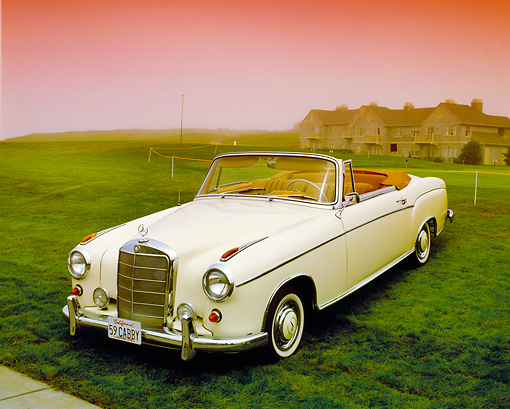 AUT 05 RK0361 04 © Kimball Stock 1960 Mercedes-Benz 220 SE Convertible Yellow 3/4 Front View On Grass Filtered