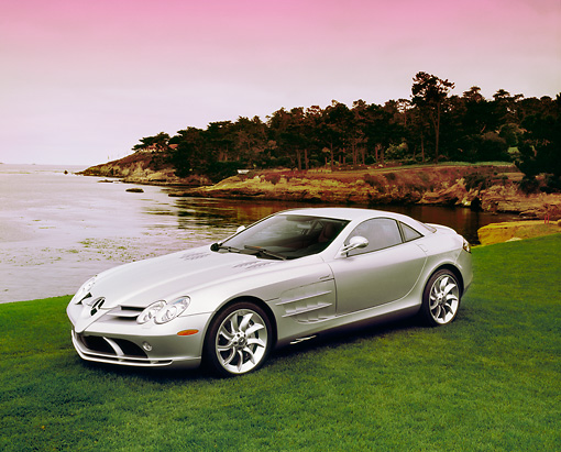 AUT 05 RK0367 04 © Kimball Stock 2005 Mercedes-Benz SLR McLaren Silver 3/4 Front View On Grass By Water Filtered