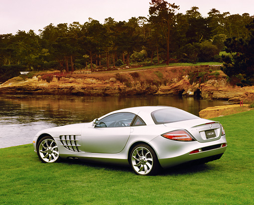 AUT 05 RK0371 01 © Kimball Stock 2005 Mercedes-Benz SLR McLaren Silver 3/4 Rear View On Grass By Water Filtered