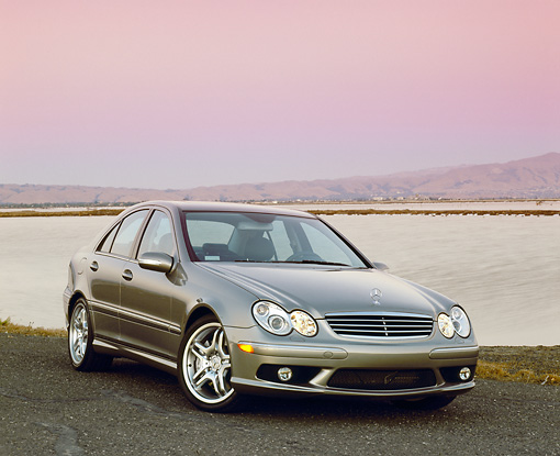 AUT 05 RK0374 02 © Kimball Stock 2005 Mercedes C55 AMG Sports Sedan Silver 3/4 Front View By Water