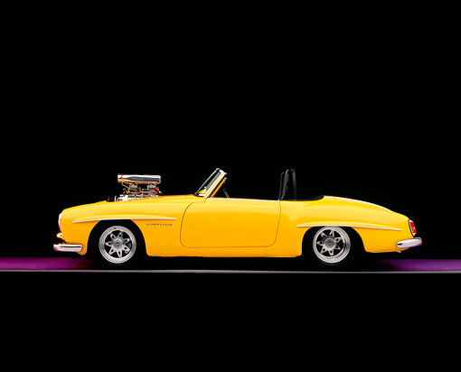 AUT 05 RK0481 03 © Kimball Stock 1957 Mercedes-Benz 190SL Convertible Yellow Profile View On Gray Line Purple Floor Studio