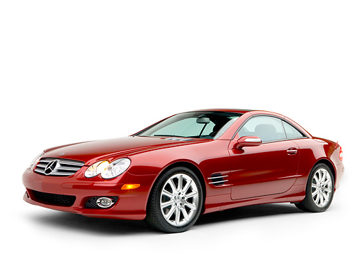 AUT 05 RK0498 01 © Kimball Stock 2007 Mercedes-Benz SL550 Roadster Storm Red 3/4 Side View Studio