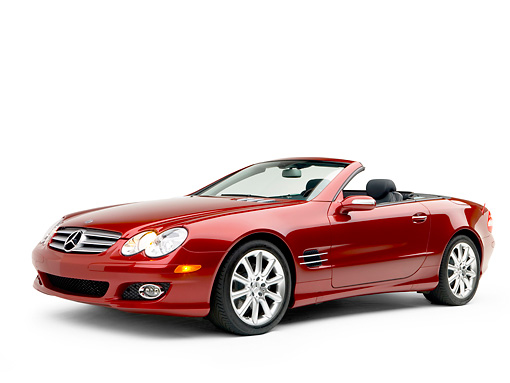 AUT 05 RK0499 01 © Kimball Stock 2007 Mercedes-Benz SL550 Roadster Storm Red 3/4 Side View Studio