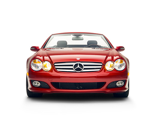 AUT 05 RK0500 01 © Kimball Stock 2007 Mercedes-Benz SL550 Roadster Storm Red Low Head On View Studio