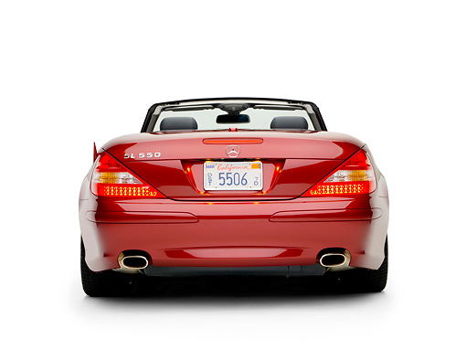 AUT 05 RK0503 01 © Kimball Stock 2007 Mercedes-Benz SL550 Roadster Storm Red Low Rear View Studio