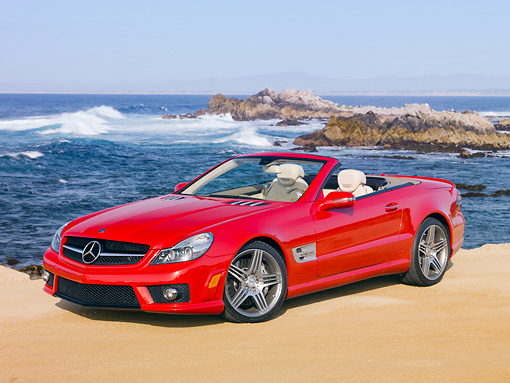 AUT 05 RK0612 01 © Kimball Stock 2010 Mercedes-Benz SL63 Convertible Red 3/4 Front View On Beach