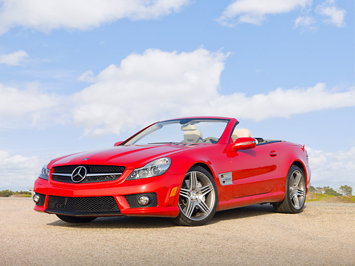 AUT 05 RK0613 01 © Kimball Stock 2010 Mercedes-Benz SL63 Convertible Red 3/4 Front View On Gravel