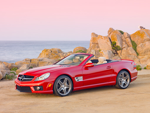 AUT 05 RK0614 01 © Kimball Stock 2010 Mercedes-Benz SL63 Convertible Red 3/4 Side View On Beach
