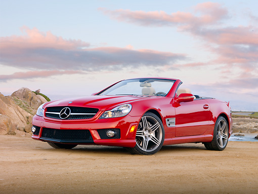 AUT 05 RK0619 01 © Kimball Stock 2010 Mercedes-Benz SL63 Convertible Red 3/4 Front View On Beach