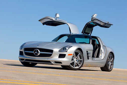 AUT 05 RK0658 01 © Kimball Stock 2011 Mercedes-Benz SLS AMG Silver 3/4 Front View On Roof Of Parking Garage