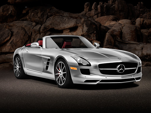 AUT 05 RK0664 01 © Kimball Stock 2012 Mercedes-Benz SLS AMG Roadster Silver 3/4 Front View On Pavement By Rock Wall